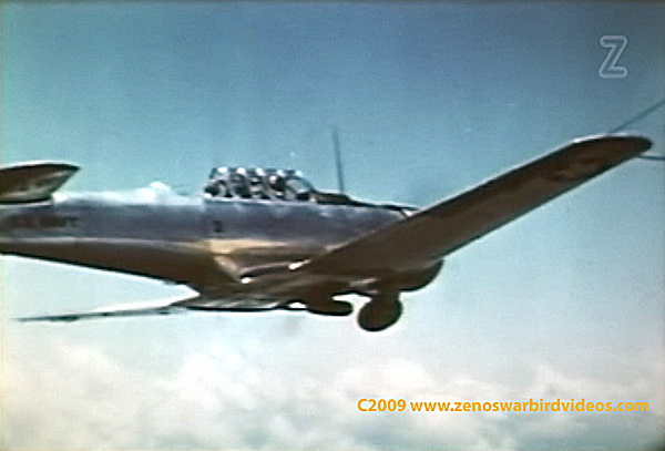Photo of a North American AT-6 SNJ in flight.